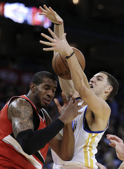 Golden State Warriors' Klay Thompson, right, strips the ball from Portland Trail Blazers' LaMarcus Aldridge during the first half of an NBA basketball game Friday, Jan. 11, 2013, in Oakland, Calif. (AP Photo/Ben Margot)