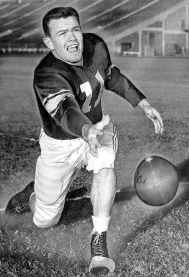 Darrell Royal's performance as Oklahoma U's new T quarterback sparked the Sooners' drive to another Big Seven title and high national recognition in 1949. Here the OU handyman is shown getting off a pitchout to a backfield teammate. OKLAHOMAN ARCHIVE PHOTO