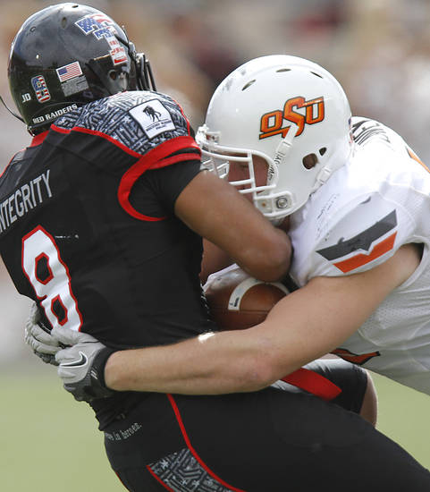 Oklahoma State Cowboys linebacker Caleb Lavey (45) stops Texas Tech Red Raiders wide receiver Jacoby Franks (8) during the college football game between the Oklahoma State University Cowboys (OSU) and Texas Tech University Red Raiders (TTU) at Jones AT&T Stadium on Satruday, Nov. 12, 2011. in Lubbock, Texas.  Photo by Chris Landsberger, The Oklahoman  ORG XMIT: KOD