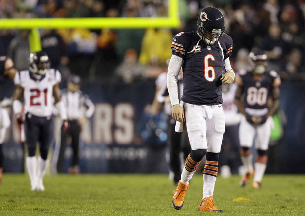 Chicago Bears quarterback Jay Cutler (6) walks off the field after he threw an illegal forward pass and took a late hit by Houston Texans linebacker Tim Dobbins in the first half of an NFL football game in Chicago, Sunday, Nov. 11, 2012. The Texans won 13-6. Cutler did not return in the second half after suffering a concussion. (AP Photo/Nam Y. Huh)