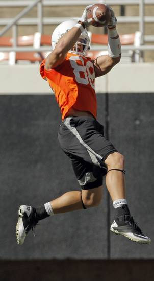 Kevin Johnson (88) makes a catch during OSU spring football practice at Boone Pickens Stadium on the campus of Oklahoma State University in Stillwater, Okla., Monday, March 12, 2012. Photo by Nate Billings, The Oklahoman