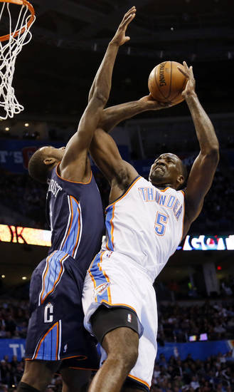 Oklahoma City's Kendrick Perkins (5) tries to shoot against Charlotte's Michael Kidd-Gilchrist (14) during an NBA basketball game between the Oklahoma City Thunder and Charlotte Bobcats at Chesapeake Energy Arena in Oklahoma City, Monday, Nov. 26, 2012.  Photo by Nate Billings , The Oklahoman