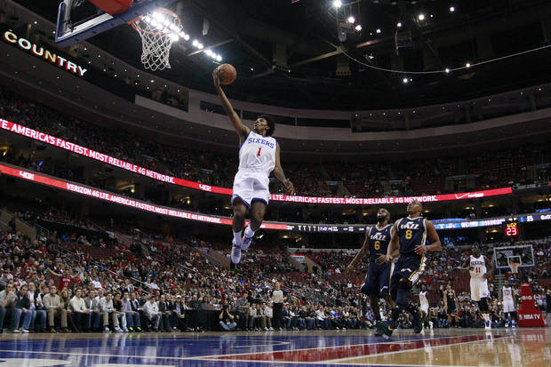 Philadelphia 76ers' Nick Young (1) goes up for a shot as Utah Jazz's Jamaal Tinsley (6) and Randy Foye (8) look on during the first half of an NBA basketball game on Friday, Nov. 16, 2012, in Philadelphia. (AP Photo/Matt Slocum)
