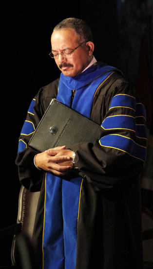 Dr. Alan Martin,  Dean of Biblical Studies bows his head in prayer during the inauguration of John deSteiguer as the new President of Oklahoma Christian University in Oklahoma City , Monday August 27, 2012. Photo By Steve Gooch, The Oklahoman