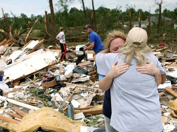 Standing in the middle of her destroyed home, Shelley Heston Bolles gets a hug from a family member in Little Axe, Oklahoma on Tuesday, May 11, 2010. (AP Photo/The Oklahoman, John Clanton) ORG XMIT: OKOKL105
