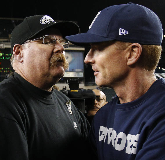 Philadelphia Eagles head coach Andy Reid, left, and Dallas Cowboys head coach Jason Garrett embrace following their NFL football game, Sunday, Nov. 11, 2012, in Philadelphia. Dallas won 38-23. (AP Photo/Philadelphia Daily News, David Maialetti) THE EVENING BULLETIN OUT, TV OUT; MAGS OUT; NO SALES