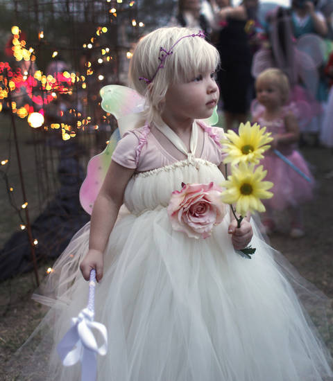 Riley Cranford, 2 1/2, plays with her wand during the Fairy Ball in the Paseo Saturday, September 24, 2011. Photo by Doug Hoke, The Oklahoman.