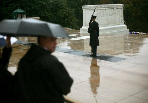 Tourists watch a guard on duty at the Tomb of the Unknowns at Arlington National Cemetery in Arlington, Virginia on Wednesday, Oct. 12, 2011. Veterans from Oklahoma visited the National WWII Memorial during an Oklahoma Honor Flight to Virginia and Washington D.C. on Wednesday, Oct. 12, 2011. Photo by John Clanton, The Oklahoman ORG XMIT: KOD