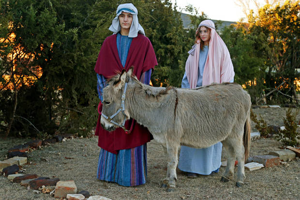 Shane Sellers, 15, and Arin Glennie, 14, pose for a photo for the Road to Bethlehem scene as part of the Boys Ranch Town annual drive-thru Christmas program. PHOTO BY BRYAN TERRY, THE OKLAHOMAN. <strong>BRYAN TERRY</strong>