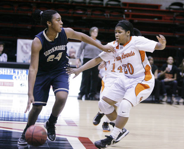Booker T. Washington Hornets No.20 Rachel Block guards Southmoore Lady Sabercats No.24 Kyeria Hannah during the class 6A state tournament girls quarterfinal basketball game in Skiatook, Okla., taken on March 7,2013. JAMES GIBBARD/Tulsa World