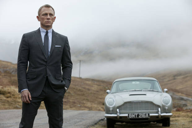 "Daniel Craig as James Bond, seen with 007's beloved silver birch Aston-Martin DB5 in the action thriller ""Skyfall."" SONY PICTURES PHOTO <strong>Francois Duhamel</strong>"