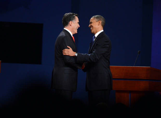 President Barack Obama and former Massachusetts Governor Mitt Romney shake hands at the start of the presidential debate at the University of Denver Wednesday, Oct. 3, 2012, in Denver. (AP Photo/The Denver Post, Craig F Walker) MAGS OUT; TV OUT; INTERNET OUT ORG XMIT: CODEN213