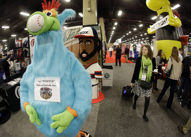 Team mascots are displayed at the baseball winter meetings trade show. Tuesday, Dec. 4, 2012, in Nashville, Tenn. Companies pitch their wares to both major and minor league teams, and that includes every product imaginable. (AP Photo/Mark Humphrey)