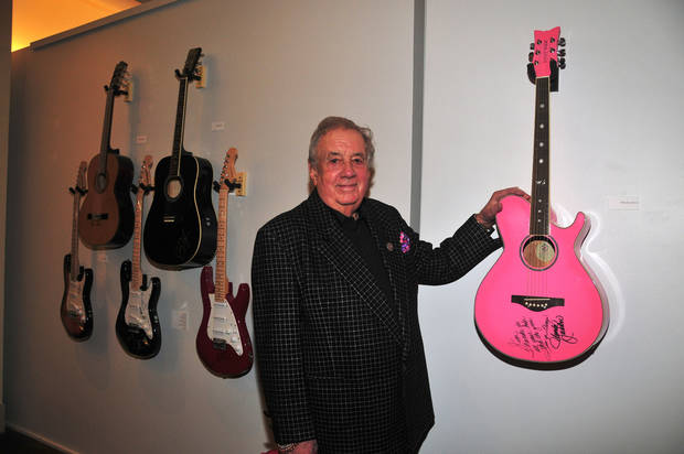 "Music impresario Jim Halsey poses with Wanda Jackson's guitar at the January opening event for the exhibit ""Starmaker: Jim Halsey and the Legends of Country Music"" at the Gaylord-Pickens Oklahoma Heritage Museum. the exhibit is on view through May 18. Photo by Captured Moments Photography <strong></strong>"