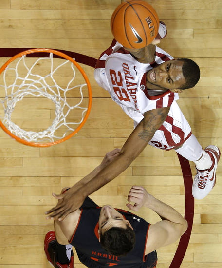 Oklahoma's Amath M'Baye (22) goes to the basket past Texas Tech's Dejan Kravic (11) during an NCAA college basketball game between the University of Oklahoma and Texas Tech University at Lloyd Noble Center in Norman, Okla., Wednesday, Jan. 16, 2013. Photo by Bryan Terry, The Oklahoman