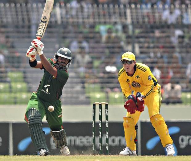Bangladesh batsman Shahriar Nafees plays a shot in front of Australian wicketkeeper Brad Haddin during their second one-day international cricket match in Dhaka, Bangladesh, Monday, April 11, 2011. Australia won the first match of the three-game series on Saturday. (AP Photo/Mir Farid) ORG XMIT: DEL109