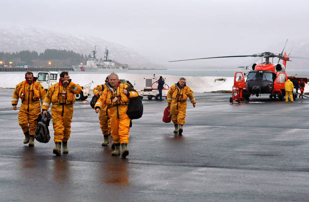 In this photo provided by the United States Coast Guard, crew members of the mobile drilling unit Kulluk arrive at Air Station Kodiak after being airlifted by a Coast Guard helicopter crew from a vessel 80 miles southwest of Kodiak, Alaska on Saturday, Dec. 29, 2012. A total of 18 crew members of the mobile drilling unit were airlifted to safety after they suffered issues and setbacks with the tug and tow. (AP Photo/United States Coast Guard, Petty Officer 3rd Class Jonathan Klingenberg)