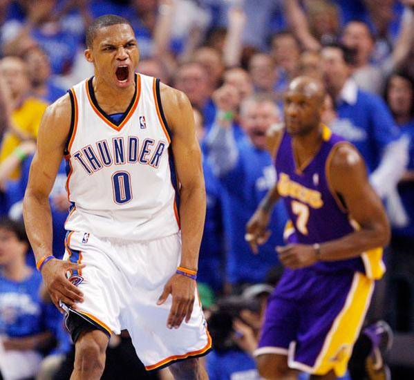 Oklahoma City's Russell Westbrook (0) reacts after dunking the ball in the fourth quarter in front of Lamar Odom (7) of L.A. during the basketball game between the Los Angeles Lakers and the Oklahoma City Thunder in the first round of the NBA playoffs at the Ford Center in Oklahoma City, Thursday, April 22, 2010. Oklahoma City won, 101-96. Photo by Nate Billings, The Oklahoman
