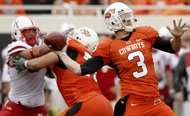 OSU's Brandon Weeden throws a pass during the college football game between the Oklahoma State Cowboys (OSU) and the Nebraska Huskers (NU) at Boone Pickens Stadium in Stillwater, Okla., Saturday, Oct. 23, 2010. Photo by Bryan Terry, The Oklahoman