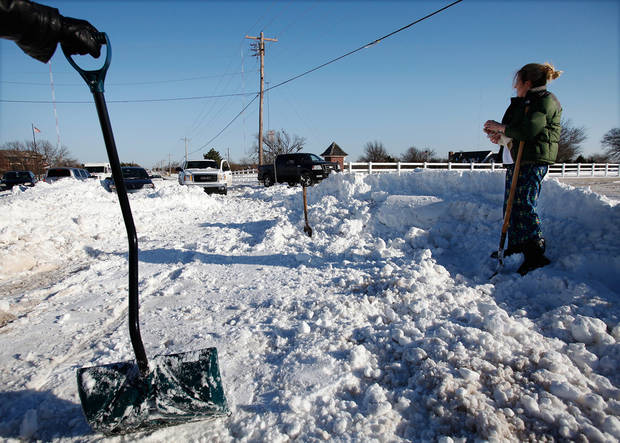 Many spent Christmas Day, Dec. 25, 2009,  digging out from record snow storm that dumped 14 inches of snow in the Oklahoma City area.   Photo by Jim Beckel, The Oklahoman