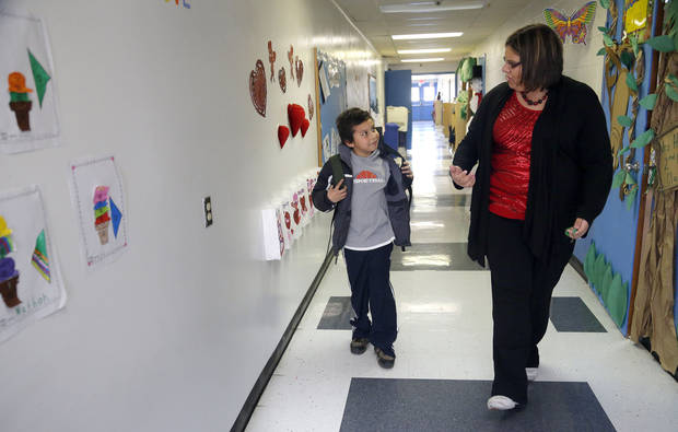 LeBryant Pigeon walk in the hallways with Beatriz Hodge at Ryal Public School, Wednesday, Feb. 13, 2013. Photo by Sarah Phipps, The Oklahoman