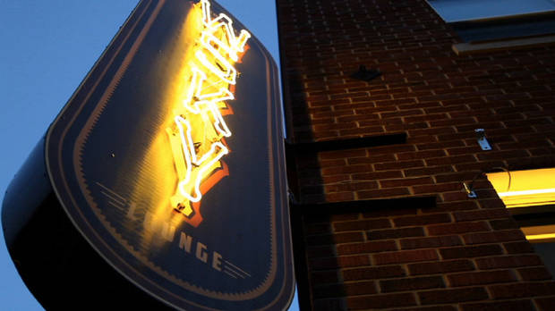 The warm glow of the neon WSKY sign greets visitors to the new lounge in Deep Deuce. Photo by David Morris, The Oklahoman <strong></strong>