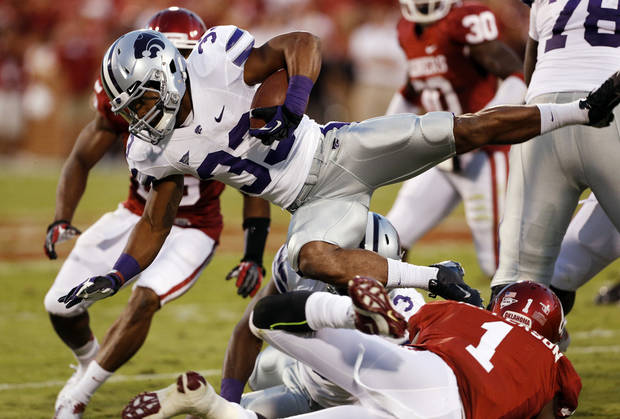 Oklahoma Sooners's Tony Jefferson (1) trips up Kansas State Wildcats's John Hubert (33) during a college football game between the University of Oklahoma Sooners (OU) and the Kansas State University Wildcats (KSU) at Gaylord Family-Oklahoma Memorial Stadium, Saturday, September 22, 2012. Photo by Steve Sisney, The Oklahoman