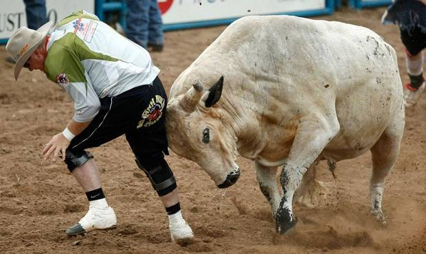 Bullfighter Rob Gann gets rammed by a bull at the International Finals Youth Rodeo at the Shawnee Expo Center on Thursday, July, 16, 2009, in Shawnee, Okla. Photo by Sarah Phipps,The Oklahoman