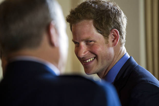 Britain's Prince Harry greets attendees before a reception in the Prince's honor at the Ambassador's residence in Washington, Thursday, May 9, 2013. (AP Photo/Jim Lo Scalzo, Pool)