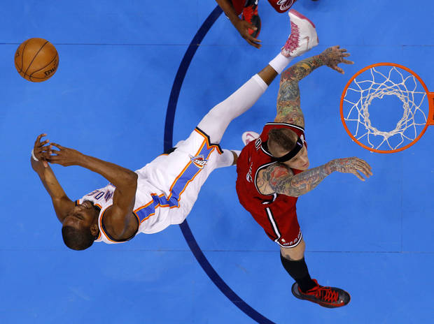 Oklahoma City's Kevin Durant (35) is fouled by Miami's Chris Andersen (11) during an NBA basketball game between the Oklahoma City Thunder and the Miami Heat at Chesapeake Energy Arena in Oklahoma City, Thursday, Feb. 15, 2013. Photo by Bryan Terry, The Oklahoman