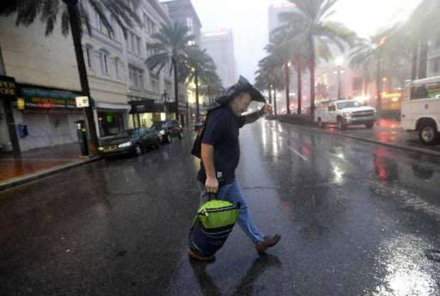 Ronnie Willis makes his way across Canal Street through the wind and rain from Hurricane Isaac Wednesday, Aug. 29, 2012, in New Orleans. (AP Photo/David J. Phillip)