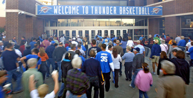 Thunder fans rush the doors in the opening night NBA basketball game between the Oklahoma City Thunder and the Milwaukee Bucks on Wednesday, Oct. 29, 2008, at the Ford Center in Oklahoma City, Okla.