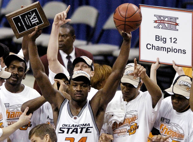OSU's Tony Allen holds up the Big 12 tournament MVP award after winning the 2004 conference title. / Staff photo by Bryan Terry.