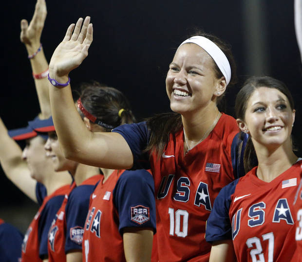 Team USA's Keilani Ricketts (10), second from right, waves to fans after the championship game of the World Cup of Softball between the United States and Australia at ASA Hall of Fame Stadium in Oklahoma City, Monday, July 2, 2012. The USA won, 3-0. Photo by Nate Billings, The Oklahoman