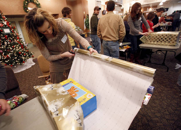 Kelly Smith wraps gifts at the Henderson HIlls Christmas Store for families in need of financial break on holiday gifts in Edmond, Okla., Thursday, Dec. 15, 2011. Photo by Sarah Phipps, The Oklahoman