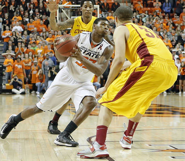 Oklahoma State Cowboys' Marcus Smart (33) drives past Iowa State Cyclones' Georges Niang (31) for the game winning shot in the 78-76 win over Iowa State during the college basketball game between the Oklahoma State University Cowboys (OSU) and the Iowa State University Cyclones (ISU) at Gallagher-Iba Arena on Wednesday, Jan. 30, 2013, in Stillwater, Okla.  Photo by Chris Landsberger, The Oklahoman