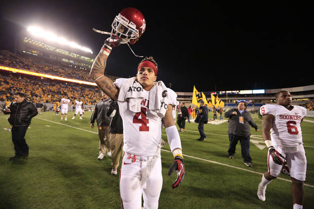 Oklahoma's Kenny Stills (4) walks off Mountaineer Field following their victory against West Virginia in an NCAA college football game in Morgantown, W.Va., Saturday, Nov. 17, 2012. Oklahoma won 50-49. (AP Photo/Christopher Jackson)