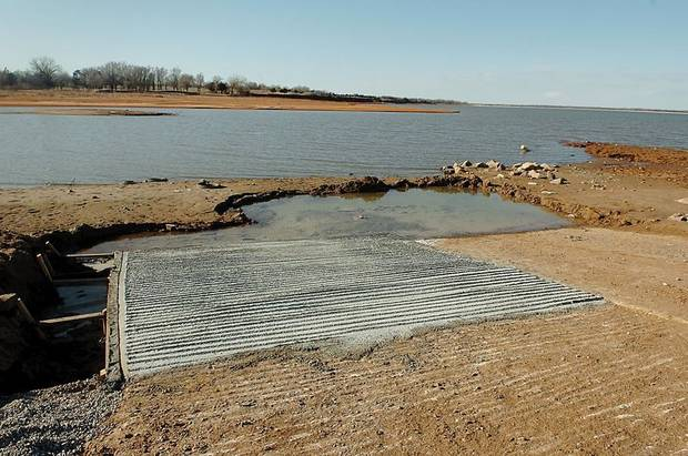 A boat ramp lies exposed in Canton Lake as the water level dropped. (Enid News & Eagle photo)