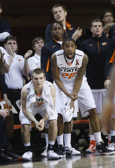 Oklahoma State guard Phil Forte (13) and forward Michael Cobbins (20) cheer from the bench in the second half of an NCAA college basketball game in Stillwater, Okla., Saturday, March 9, 2013. Oklahoma State won 76-70. (AP Photo/Sue Ogrocki)