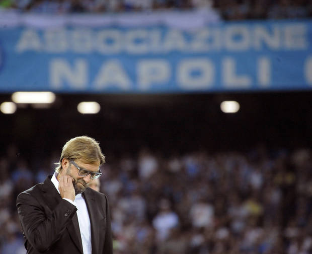 Dortmund head coach Juergen Klopp walks on the pitch during the Champions League, Group F, first leg soccer match between Napoli and Borussia Dortmund, at the Naples San Paolo stadium, Italy, Wednesday, Sept. 18, 2013. Napoli won 2-1. (AP Photo/Salvatore Laporta)