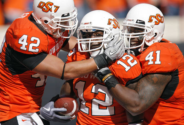Oklahoma State's Justin Gent (42), Johnny Thomas (12) and Orie Lemon (41) celebrate after Thomas' interception during the college football game between the Oklahoma State University Cowboys (OSU) and the Baylor University Bears at Boone Pickens Stadium in Stillwater, Okla., Saturday, Nov. 6, 2010. Photo by Chris Landsberger, The Oklahoman