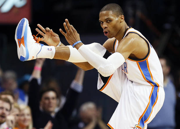 Oklahoma City&#039;s Russell Westbrook (0) reacts after hitting a 3-point shot during an NBA basketball game between the Oklahoma City Thunder and Minnesota Timberwolves at Chesapeake Energy Arena in Oklahoma City, Friday, Feb. 22, 2013. Oklahoma City won, 127-111. Photo by Nate Billings, The Oklahoman