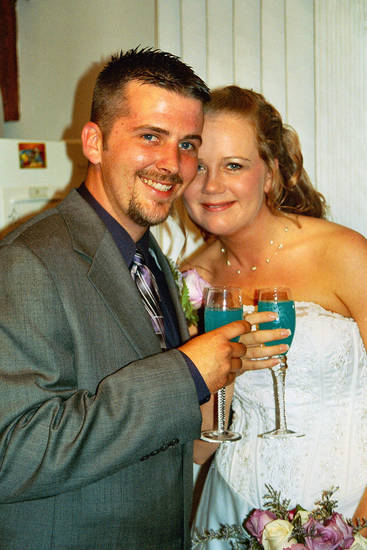 "My middle son Jesse and my sweet daughter-in-law ""Emmy"" on their wedding day!<br/><b>Community Photo By:</b> Teresa Chapman<br/><b>Submitted By:</b> Teresa, Bethany"