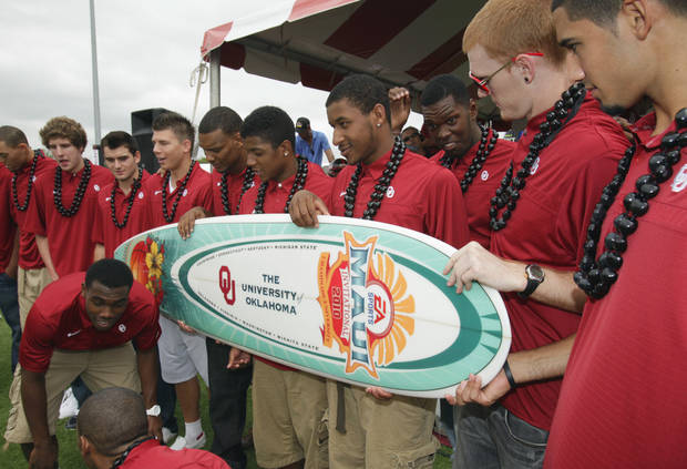 The OU men's basketball team accepts a surfboard during fan fest before the college football game between the University of Oklahoma Sooners (OU) and Florida State University Seminoles (FSU) at the Gaylord Family-Oklahoma Memorial Stadium on Saturday, Sept. 11 2010, in Norman, Okla.   Photo by Steve Sisney, The Oklahoman