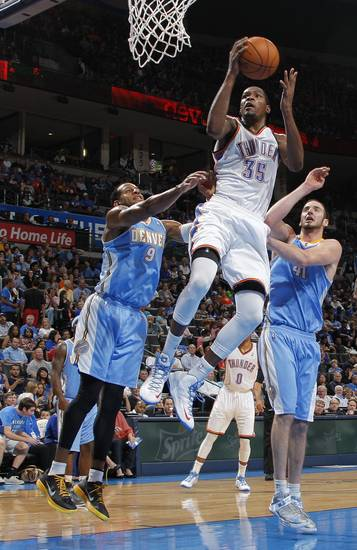 Oklahoma City&#039;s Kevin Durant (35) goes up for a shot during the NBA preseason basketball game between the Oklahoma City Thunder and the Denver Nuggets at the Chesapeake Energy Arena, Sunday, Oct. 21, 2012. Photo by Garett Fisbeck, The Oklahoman