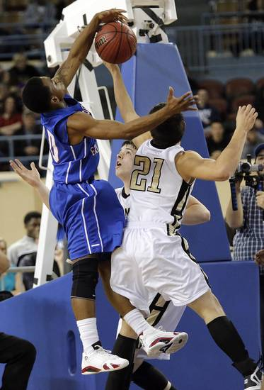 Millwood's Chris Crook (10) blocks a shot by Okemah's Dion Scott (21) during the state high school basketball tournament Class 3A boys championship game between Millwood High School and Okemah High School at the State Fair Arena on Saturday, March 9, 2013, in Oklahoma City, Okla. Photo by Chris Landsberger, The Oklahoman