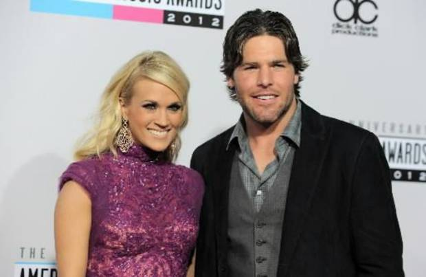 Carrie Underwood and her husband, Mike Fisher, arrive at the show.