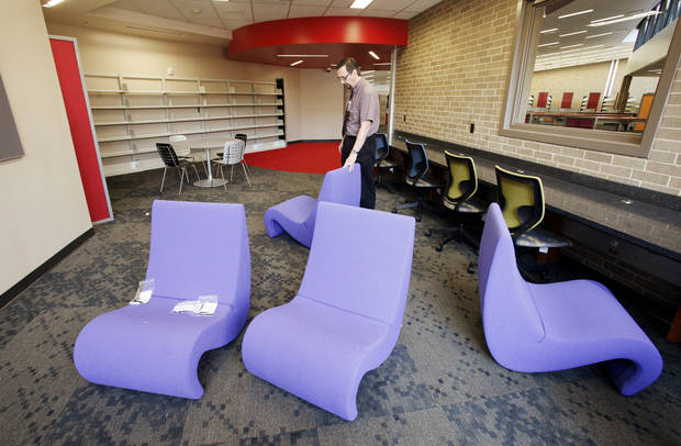 Randy Wayland, branch manager, looks at new furnishings in the teen room of the remodeled Southern Oaks Library.  Photo by Paul B. Southerland, The Oklahoman <strong>PAUL B. SOUTHERLAND - PAUL B. SOUTHERLAND</strong>