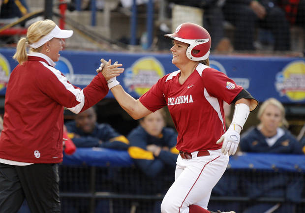 Oklahoma's Georgia Casey slaps hands with coach Patty Gsso after she hit a home run against California in the sixth inning of their Women's College World Series game at ASA Hall of Fame Stadium in Oklahoma City, Friday, June 1, 2012.  Photo by Bryan Terry, The Oklahoman