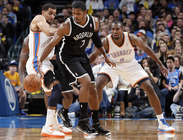 Oklahoma City's Thabo Sefolosha (2) tries to defend on Brooklyn Nets' Joe Johnson (7) during the NBA basketball game between the Oklahoma City Thunder and the Brooklyn Nets at the Chesapeake Energy Arena on Wednesday, Jan. 2, 2013, in Oklahoma City, Okla. Photo by Chris Landsberger, The Oklahoman